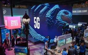 Visitors tour the Intel booth on Monday, Feb. 26, 2018, at Mobile World Congress.