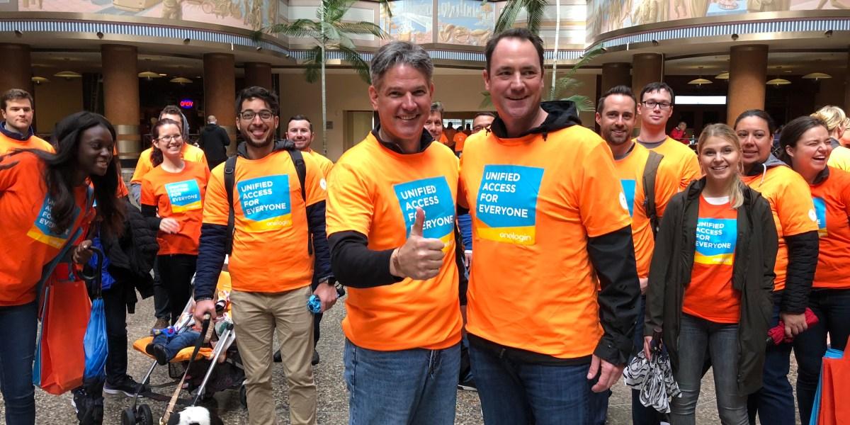 OneLogin employees in orange shirts