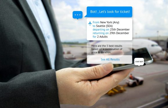Chat bot and future marketing concept . Customer hand holding tablet look for ticket and popup out tablet screen with automatic chatbot message screen , airport background