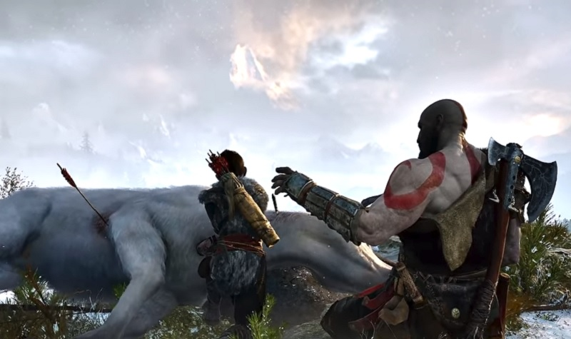 Kratos is trying to comfort his son in God of War.