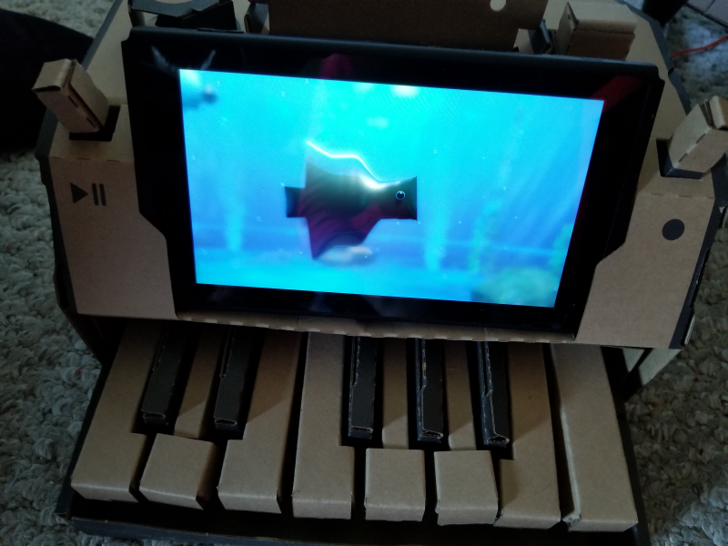Custom fish swimming in aquarium, shown on Nintendo Labo piano