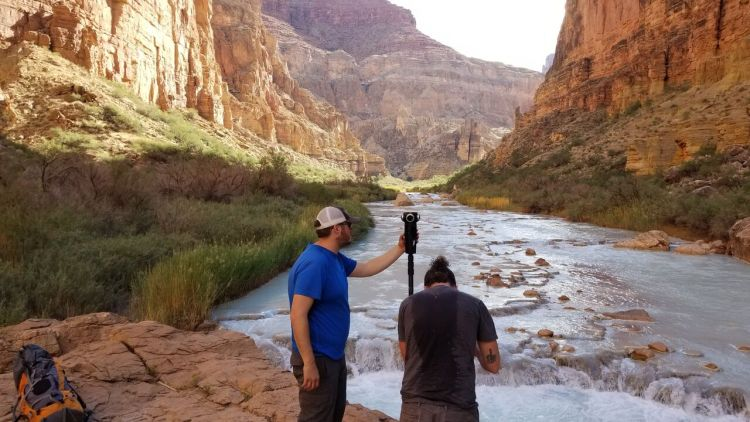 """Matt Rowell, director of photography for VR documentary """"as it is""""setting up a shot in the Grand Canyon."""