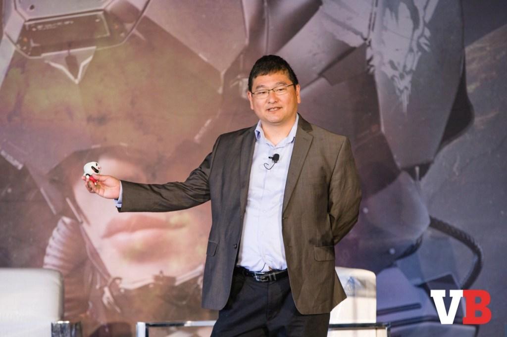 Dean Takahashi holds Cuphead at GamesBeat Summit 2018.