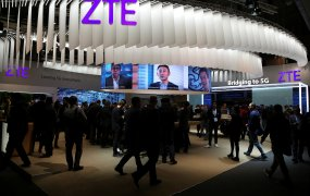 People stand at ZTE's booth during Mobile World Congress in Barcelona, Spain, February 27, 2017.