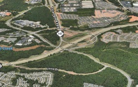 Apple is said to be focused on vacant North Carolina land at the intersection of I-540 and Davis Drive, shown here.