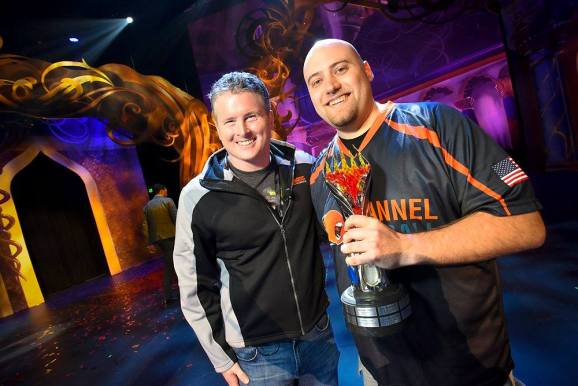 Wizards of the Coast president Chris Cocks (left) stands with 2016 Magic World Champion Brian Braun-Duin.