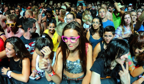 Faces in the crowd: BENICASIM, SPAIN - JULY 19: People (fans) at FIB (Festival Internacional de Benicassim) 2013 Festival on July 19, 2013 in Benicasim, Spain.