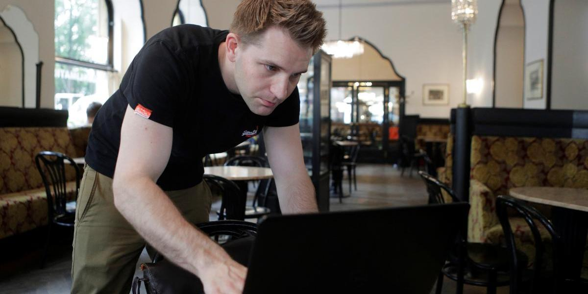 Austrian lawyer and privacy activist Max Schrems prepares his laptop during a Reuters interview in a cafe in Vienna, Austria, May 22, 2018. Picture taken May 22, 2018.