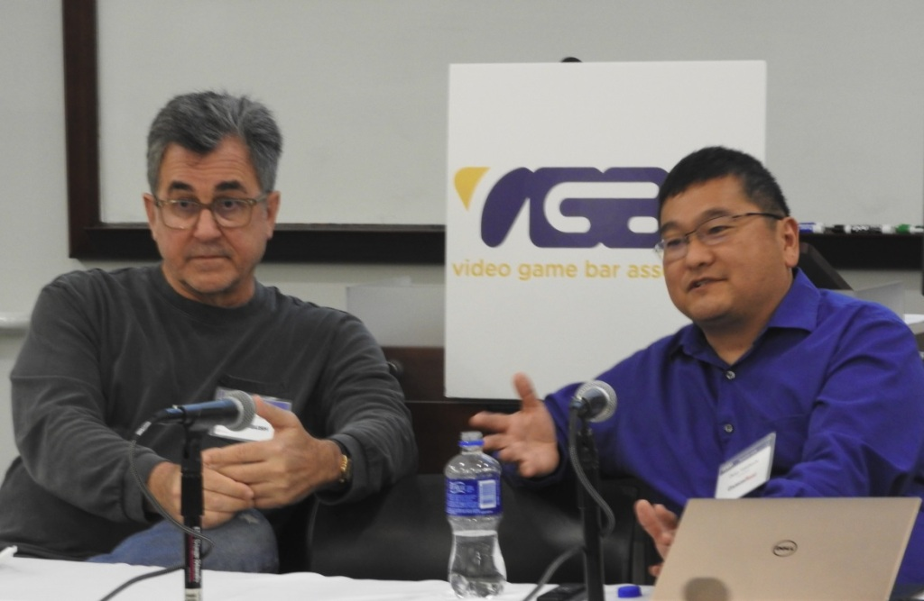 Michael Pachter of Wedbush Securities and Dean Takahashi of GamesBeat at the Video Game Bar Association.