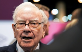 Warren Buffett, CEO of Berkshire Hathaway Inc, talks to a reporter in the exhibit hall at the company's annual meeting in Omaha, Nebraska, U.S., May 5, 2018.