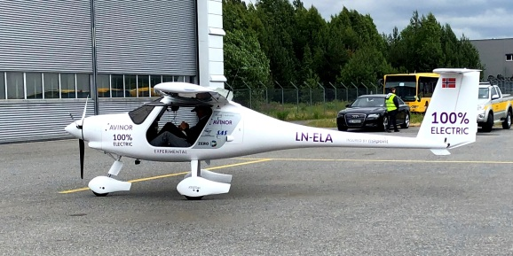 A two-seat electric plane made by Slovenian firm Pipistrel stands outside a hangar before a test flight.