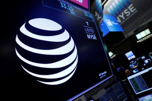 FILE PHOTO: The AT&T logo is seen on a monitor on the floor of the New York Stock Exchange (NYSE) in New York City, U.S. June 13, 2018.