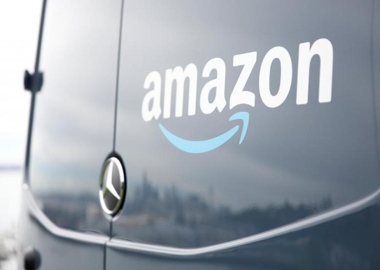 An Amazon Prime van during a press conference announcing Amazon.com's new program to help entrepreneurs build businesses delivering Amazon packages, including $1 million to fund startup costs for military veterans, at an event space in Seattle, Washington, U.S., June 27, 2018.