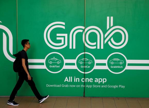 A man walks past a Grab office in Singapore March 26, 2018.