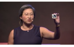 Lisa Su shows off the company's first 7-nanometer chip.
