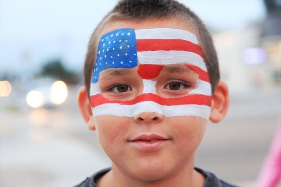 A young boy celebrates July 4 holiday in Imperial Beach, California