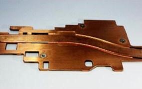 An Auras Technology copper heatsink for smartphones.