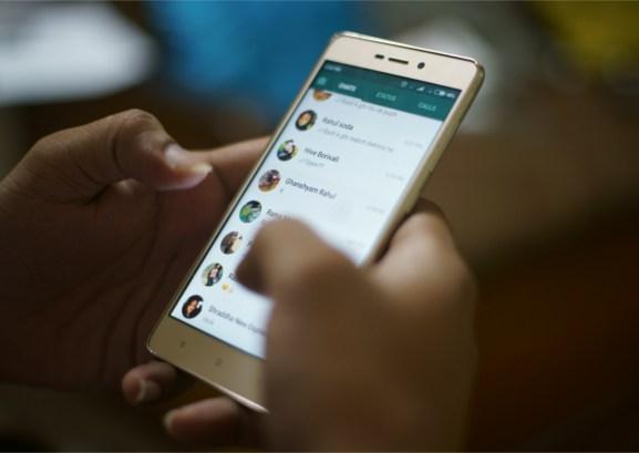 KANDIVALI, MUMBAI, MAHARASHTRA, INDIA - OCTOBER 10, 2017- A man uses WhatsApp on his cell phone at home in Mumbai, India.