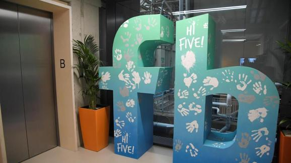 A giant logo is seen at Facebook's headquarters in London. Facebook is opening a new office, providing an extra 800 jobs.