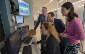 NYU  School  of  Medicine's  Department  of  Radiology  chair  Michael  Recht,  MD,  Daniel  Sodickson,  MD,  vice  chair  for  research  and  director  of  the  Center  for  Advanced  Imaging  Innovation  and  Yvonne  Lui,  MD,  director  of  artificial  intelligence,  examine  a  knee  MRI  at  NYU  Langone  Health  in  August,  2018.  Radiologists  from  NYU  School  of  Medicine  will  be  embarking  on  a  research  collaboration  with  Facebook  to  speed  up  MRI  by  up  to  10  times  faster  through  artificial  intelligence.