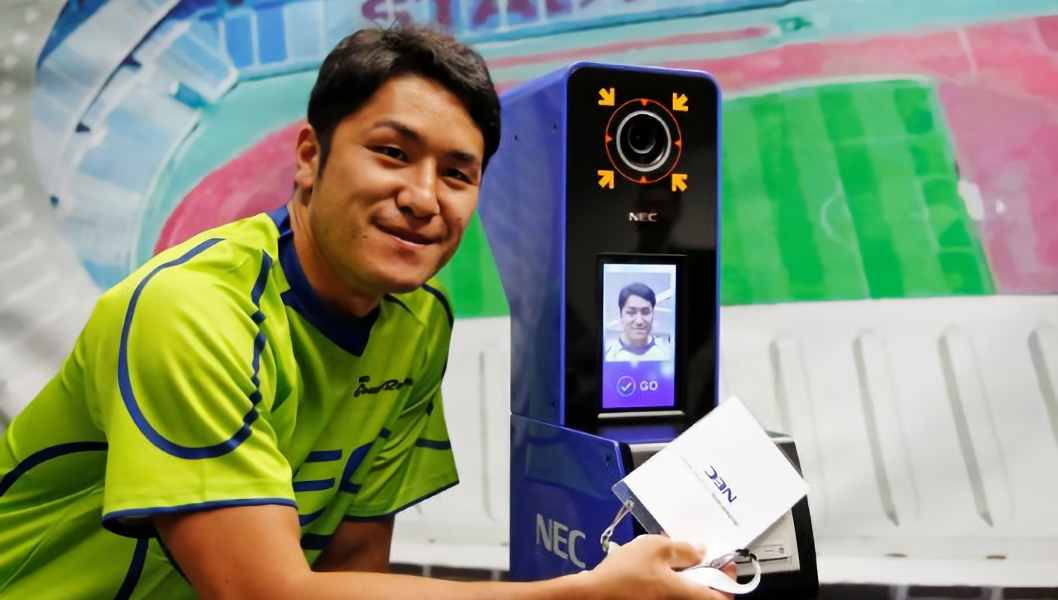 NEC Green Rockets' rugby player Teruya Goto poses with the face recognition system for Tokyo 2020 Olympics and Paralympics, which is developed by NEC corp, during its demonstration in Tokyo, Japan.
