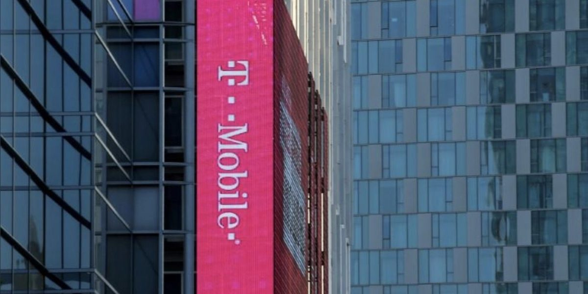 A T-Mobile logo is advertised on a building sign in Los Angeles, California.