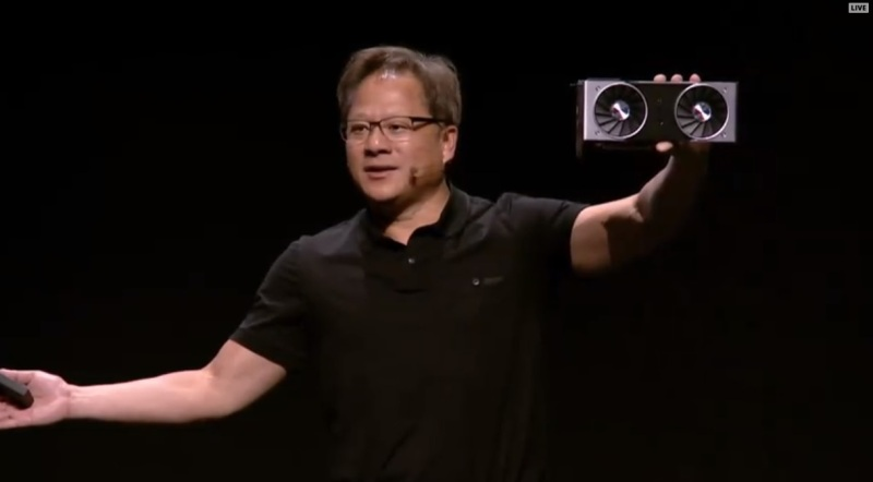 Nvidia CEO Jensen Huang shows off the Nvidia GeForce RTX 2080 Ti at Gamescom 2018.