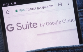 Google G Suite website displayed on smartphone in jeans pocket