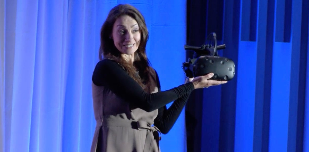 Intel's Sandra Rivera holds up a HTC Vive headset equipped with millimeter wave wireless technology.