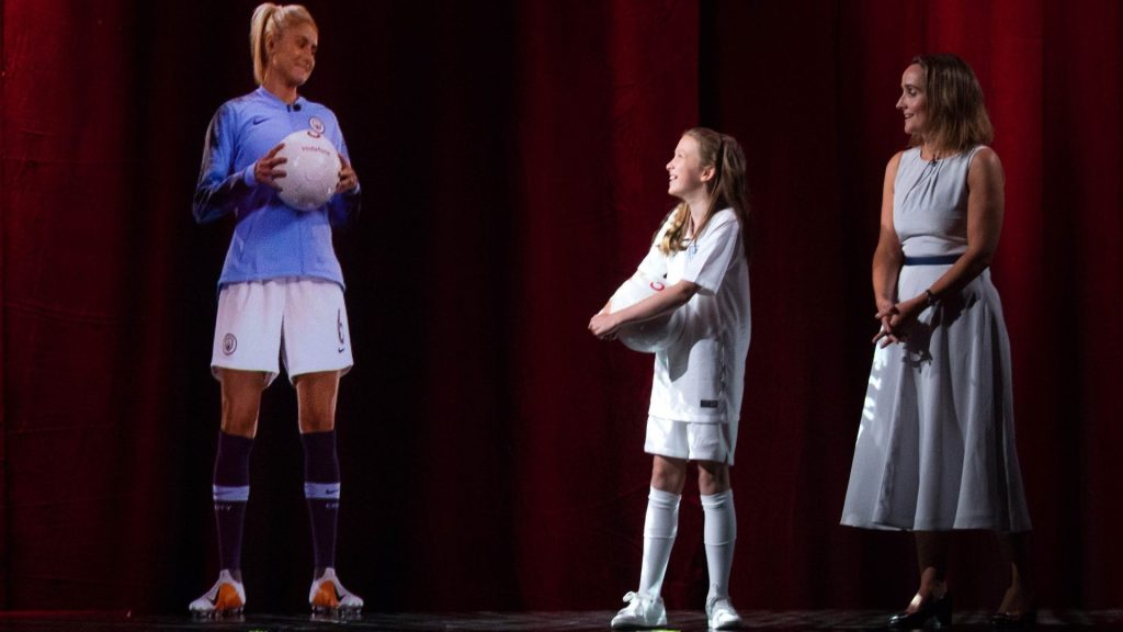 A holographic call using 5G enables a young soccer fan to meet and interact with a British soccer captain.