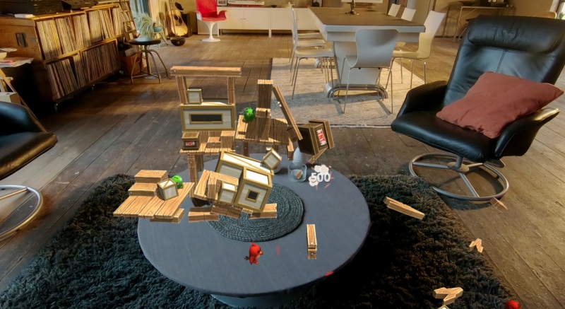 When you fire an Angry Bird at a pig fortress, the blocks come crashing down around your living room.