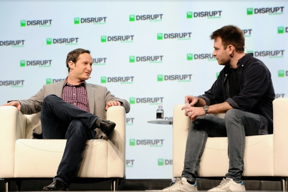 DraftKings CEO Jason Robins (left) speaks with Techcrunch writer Fitz Tepper.