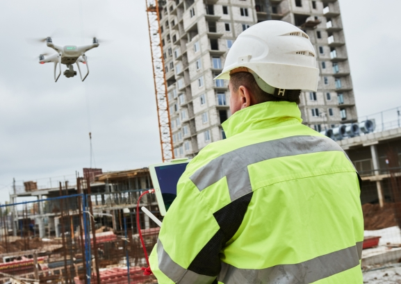 Researchers use a nailgun-equipped drone to shingle a roof