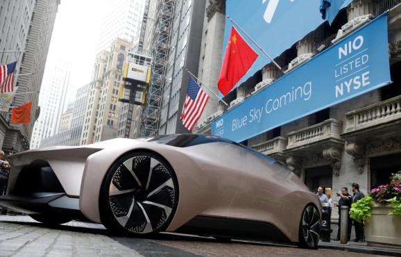 Chinese electric vehicle start-up Nio Inc. vehicle is parked in front of the New York Stock Exchange (NYSE) to celebrate the company's initial public offering (IPO) in New York, U.S., September 12, 2018.