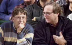 Microsoft co-founders Bill Gates and Paul Allen chat at courtside during the NBA game between the Seattle SuperSonics and the Portland Trailblazers at Key Arena in Seattle.