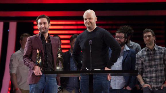 Dan Houser (right) accepts an award at DICE.
