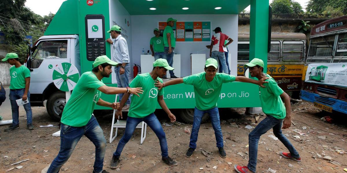 WhatsApp-Reliance Jio representatives perform in a street play during a drive by the two companies to educate users, on the outskirts of Kolkata, India, October 9, 2018.