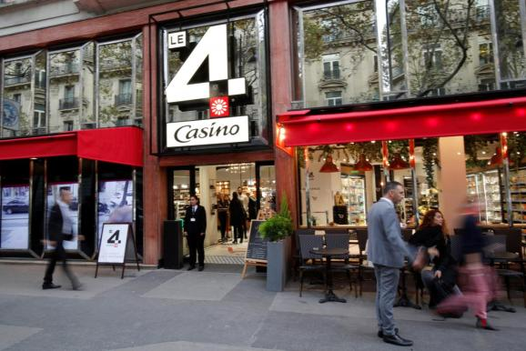"""The logo """"Le 4 Casino"""" is seen outside a high-tech store of supermarket retailer Casino in Paris, France, October 4, 2018."""