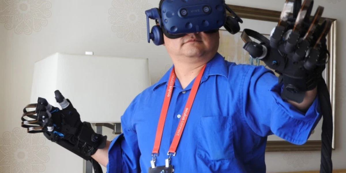 Dean Takahashi tries out the Haptx gloves with the HTC Vive VR headset.