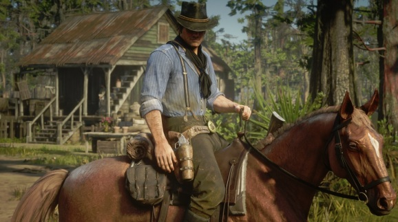 Arthur Morgan rides his horse in Red Dead Redemption 2.