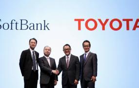 Toyota President Akio Toyoda and Executive Vice President Shigeki Tomoyama pose for a photograph with SoftBank Chairman and CEO Masayoshi Son and SoftBank Representative Director and CTO Junichi Miyakawa during joint news conference in Tokyo.