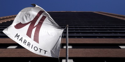 A Marriott Flag Hangs At The Entrance Of New York Downtown Hotel In Manhattan