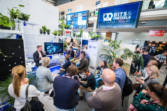 A crowd gather for a presentation by Bits and Pretzels - Day One - Image ©