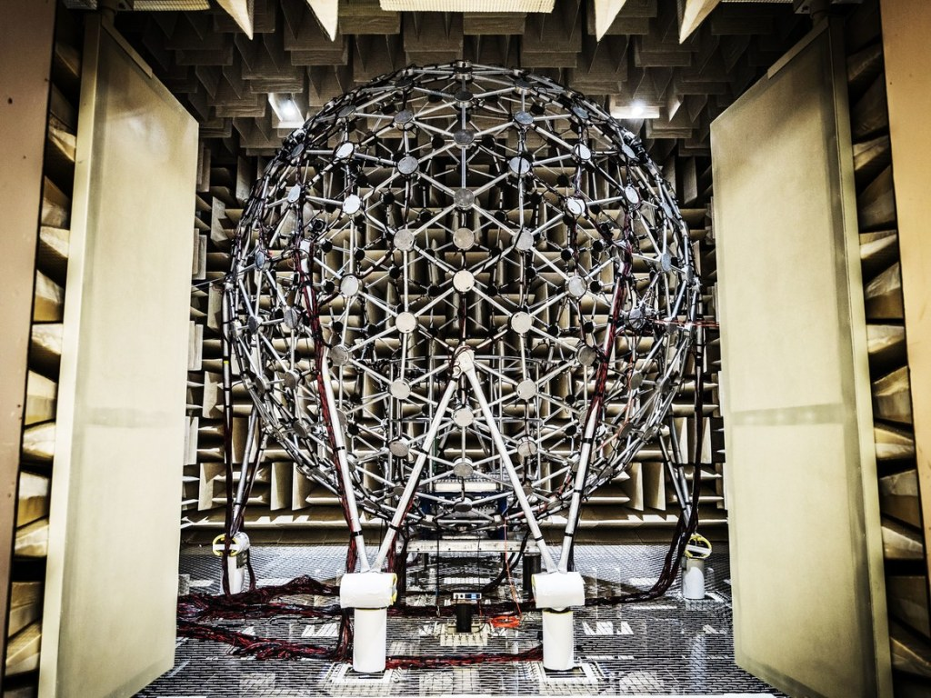"""""""The Air Force Research Lab's test facility aims 277 loudspeakers in a 14-foot sphere toward a test stand, where a subject or sensor array sits."""" Photo credit:"""