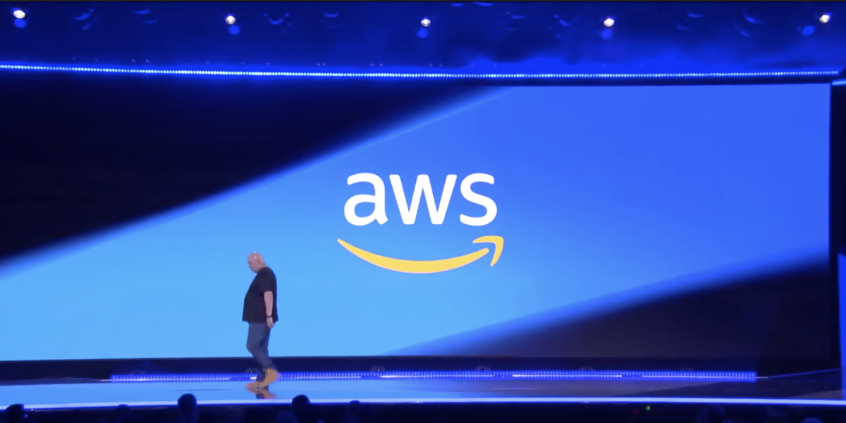 AWS CTO Werner Vogels profiled against giant blue presentation screen