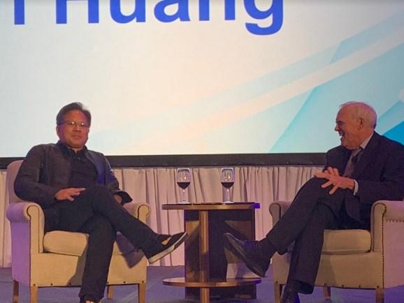 Jensen Huang (left), CEO of Nvidia, talks with former Stanford University president John Hennessy.