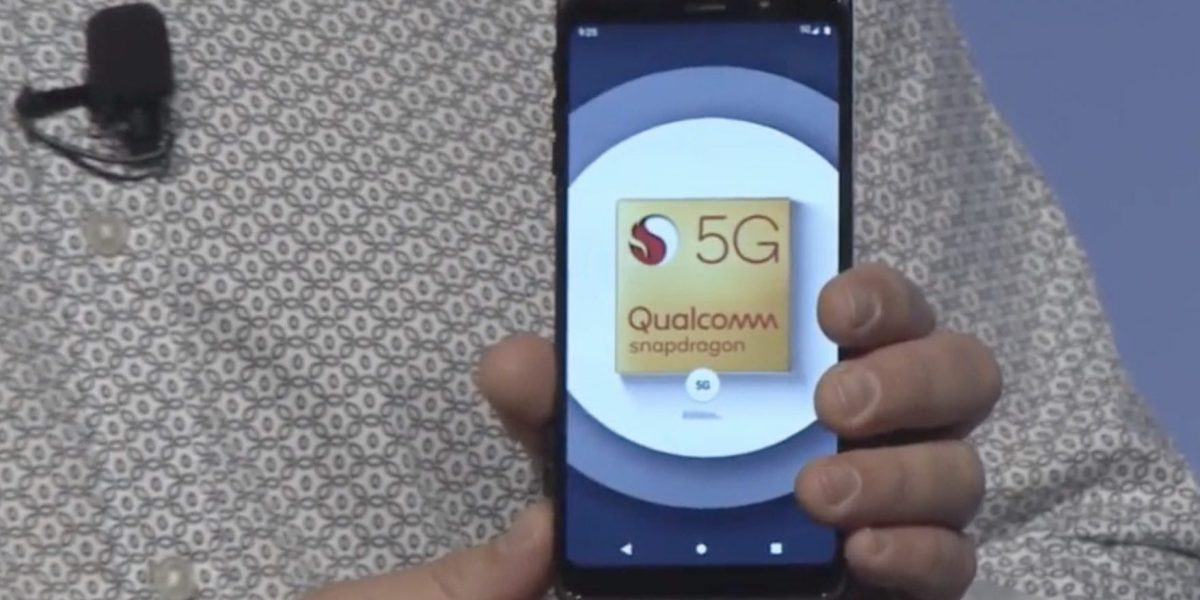 Qualcomm President Cristiano Amon shows off the company's first live 5G reference phone design.