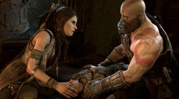 Freya and Kratos with an ailing Atreus in God of War.