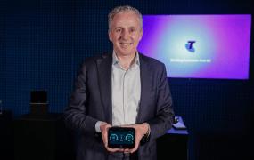 Telstra CEO Andrew Penn holds HTC's 5G Hub, a mobile hotspot.