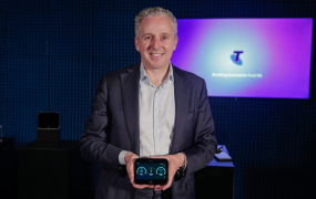 Telstra CEO Andrew Penn holds HTC's 5G Hub, a mobile hotspot.